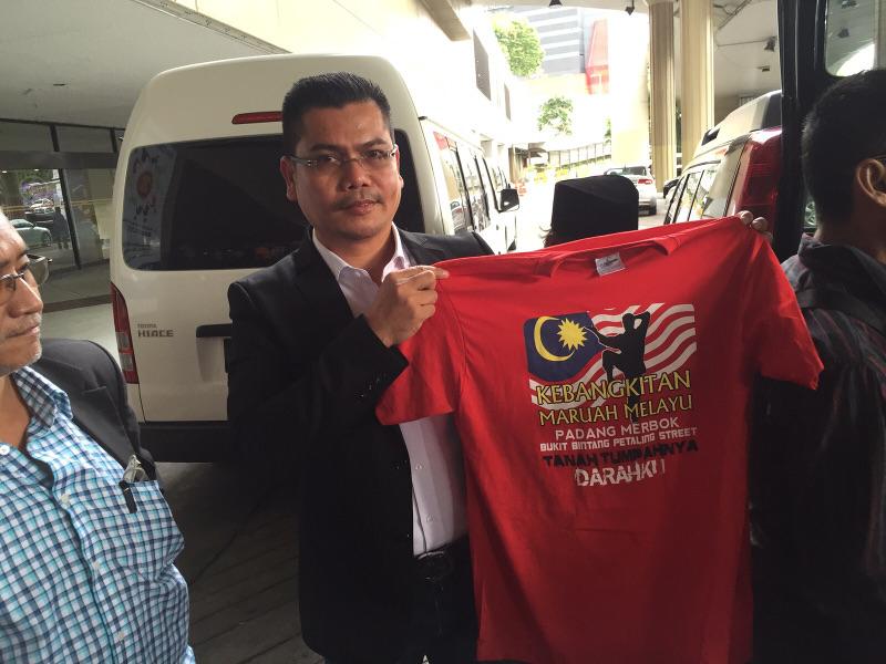 Datuk Jamal Md Yunos holds up a red T-shirt that reads in Bahasa Malaysia: Malay dignity uprising, Padang Merbok, Bukit Bintang, Petaling Street, My Homeland. — File pic