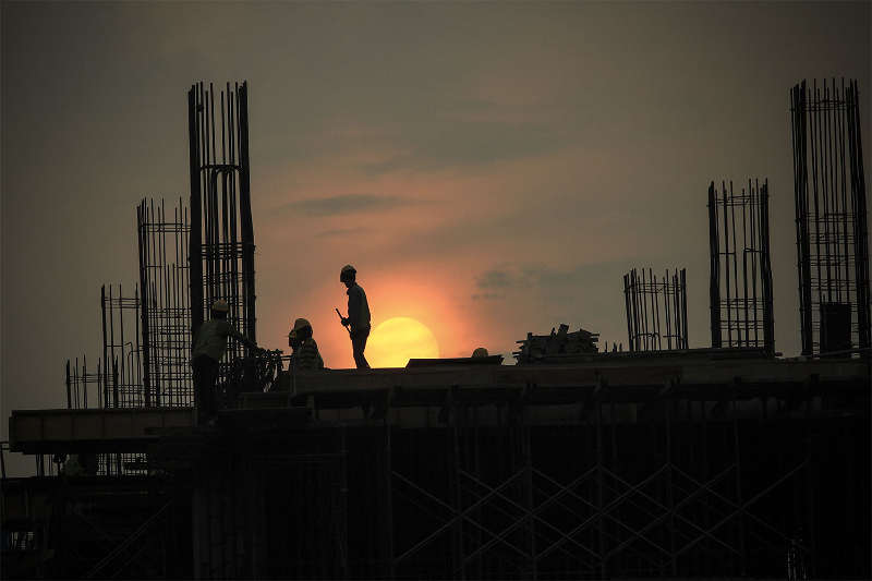 Construction workers are silhouetted against the evening sky in Kuala Lumpur September 10, 2015. The Home Ministry said there are 1.7 million foreign workers from 13 countries in Malaysia as of June 30. — Picture by Yusof Mat Isa