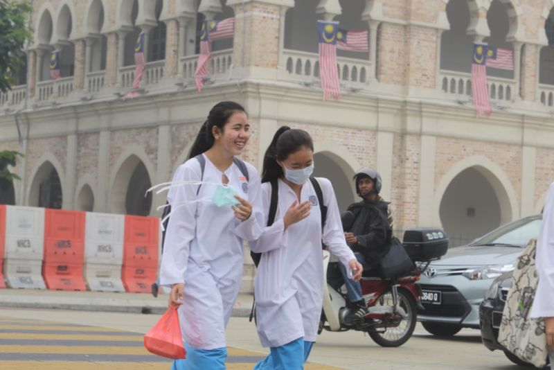 File picture shows schoolgirls crossing the road near Dataran Merdeka on a hazy day, September 14, 2015. — Picture by Choo Choy May