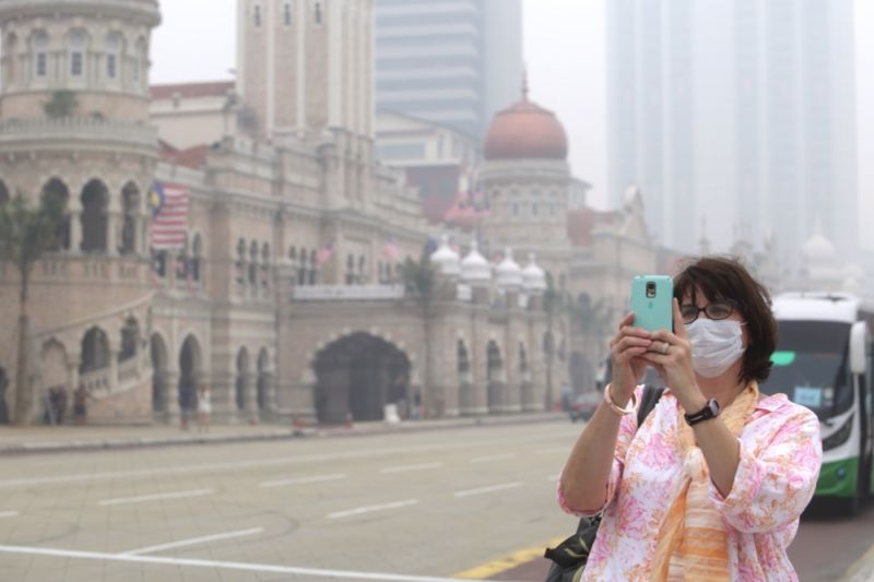 The haze in the country prompts many to wear masks as a precaution. — File pic