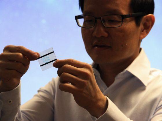 Professor Lim showing a wearable liquid-based microfluidic tactile sensor. — TODAY/Daryl Kang pics