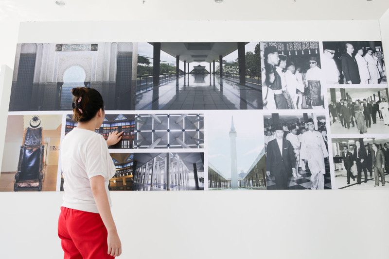 A visitor looks at photographs of Masjid Negara's past at the 50 Years National Mosque Exhibition.
