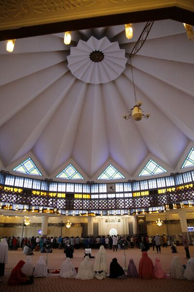 Muslims perform Friday prayers inside Masjid Negara.