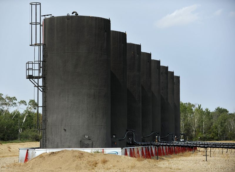 Storage tanks at Maidstone well site about 60 kilometres east of field office of Gear Energy's well sites near Lloydminster, Canada August 27, 2015. — Reuters pi