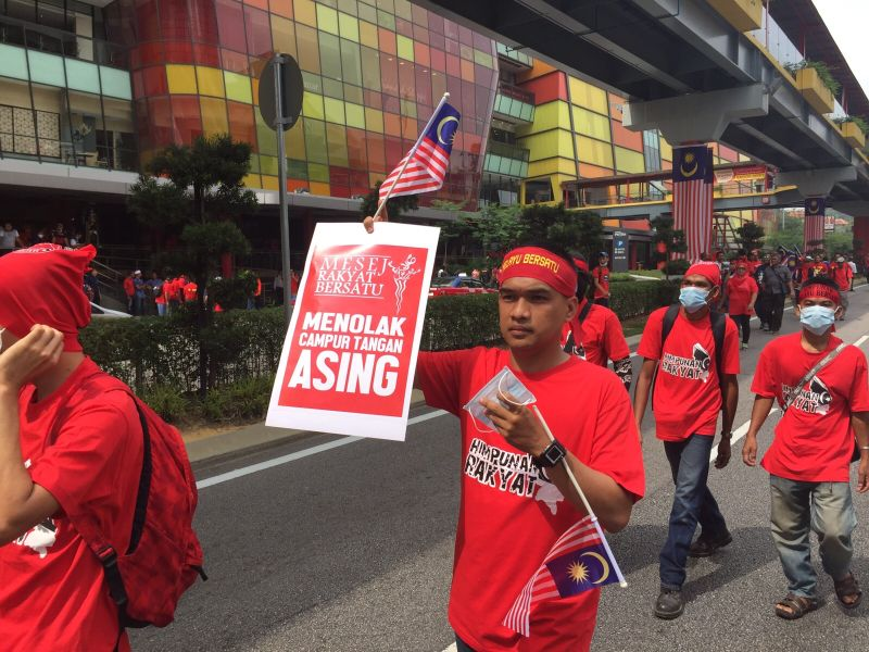Thousands of Malays wearing red shirts marched at the pro-government #Merah169 rally here on Malaysia Day. ― File pic