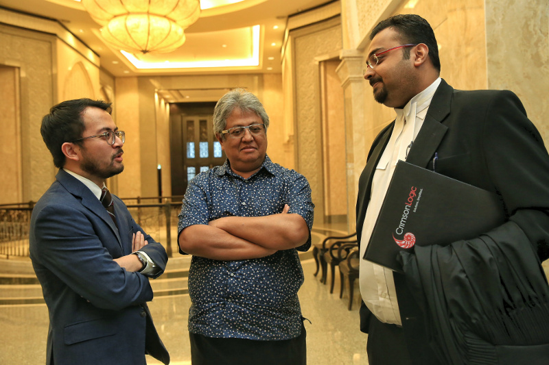 ZI Publications Sdn Bhd director Ezra Zaid, Datuk Zaid Ibrahim and lawyer Pavendeep Singh are seen at the Federal Court, Putrajaya, September 28, 2015. — Picture by Saw Siow Feng