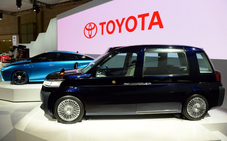 Toyota Motor Corp's 'JPN Taxi' (right) is displayed beside the 'FCV concept' vehicle at the company's booth at the Tokyo Motor Show 2013 in Tokyo November 20, 2013. — AFP pic