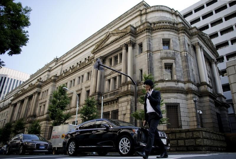 The Bank of Japan kept its negative interest rate of 0.1 per cent on bank deposits, as well as its policy of unlimited purchases of Japanese government bonds, to ensure their 10-year yields remain around zero per cent. — Reuters pic