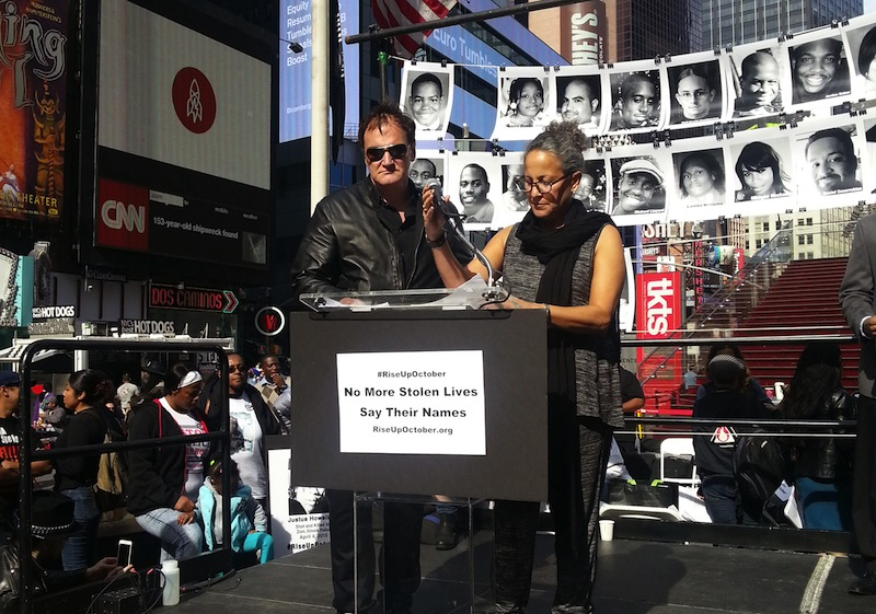 Film director Quentin Tarantino and actress Gina Belafonte read out the names of people who have died at the hands of police at a rally demanding an end to police brutality in New York's Times Square on October 22, 2015.— AFP pic