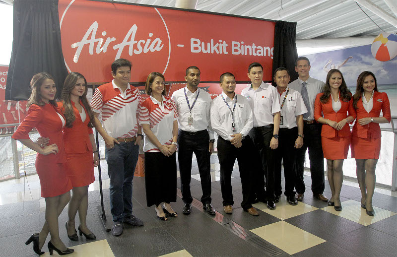 AirAsia staff members posing for a photograph during the launch of the AirAsia Bukit Bintang Monorail station, October 9, 2015. — Picture by Yusof Mat Isa