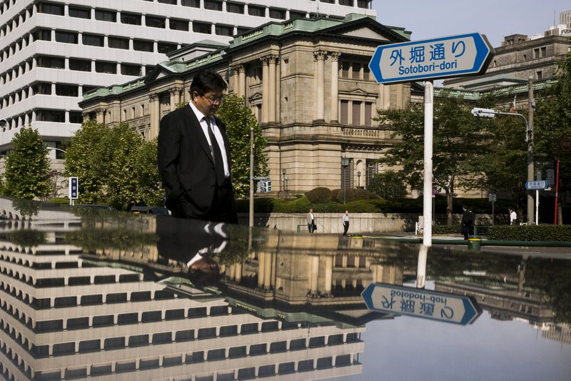 A man walks past the Bank of Japan (BOJ) building in Tokyo, October 30, 2015. — Reuters pic