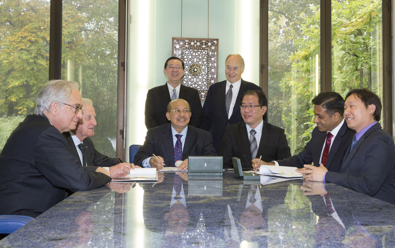 Penang Chief Minister Lim Guan Eng and His Highness the Aga Khan (standing) at the signing ceremony in Chantilly, France.
