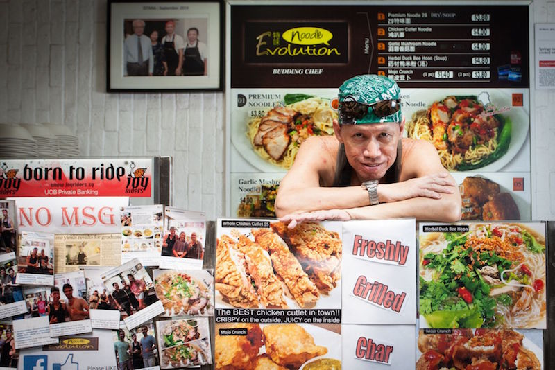 New hawker Peter Mok is pictured at his stall Noodle Evolution that opened at Lau Pa Sat last December. — TODAY pic