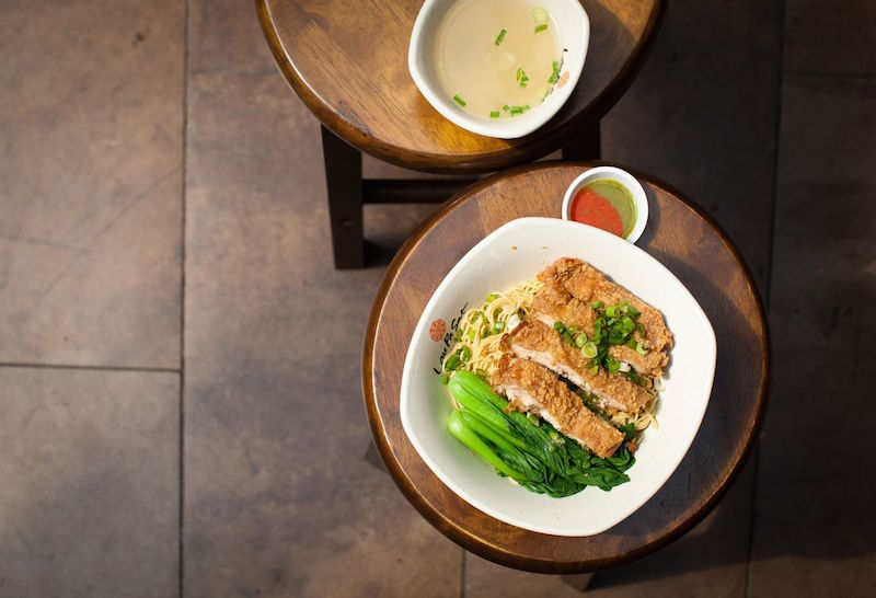 Chicken cutlet noodles and herbal duck bee hoon are some of the fare sold by new hawker Peter Mok, whose stall Noodle Evolution opened at Lau Pa Sat last December. — TODAY pic