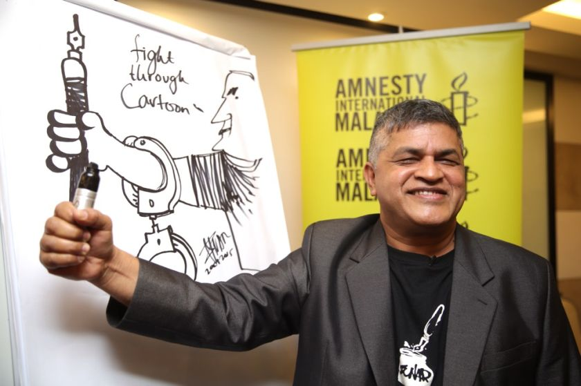 Cartoonist Zulkiflee Anwar Ulhaque has pledged to continue drawing despite the government banning some of his books, saying it was impossible for the authorities to ban his ideas. — Picture by Choo Choy May