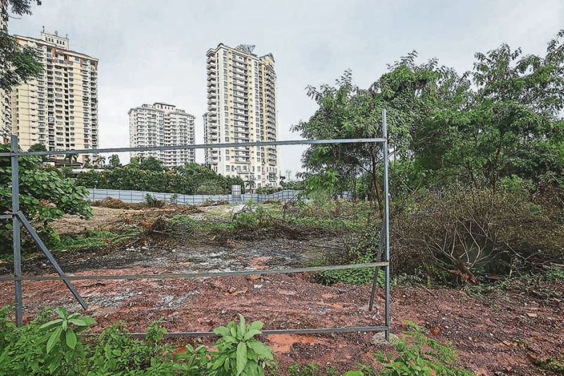 Parts of the perimeter fencing has been removed by vandals. ― Malay Mail pic