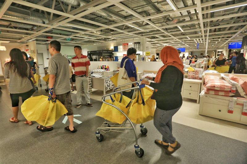Customers take a look around the new Ikea Cheras which is 20 per cent bigger than the first branch in Damansara. ― Picture by Saw Siow Feng