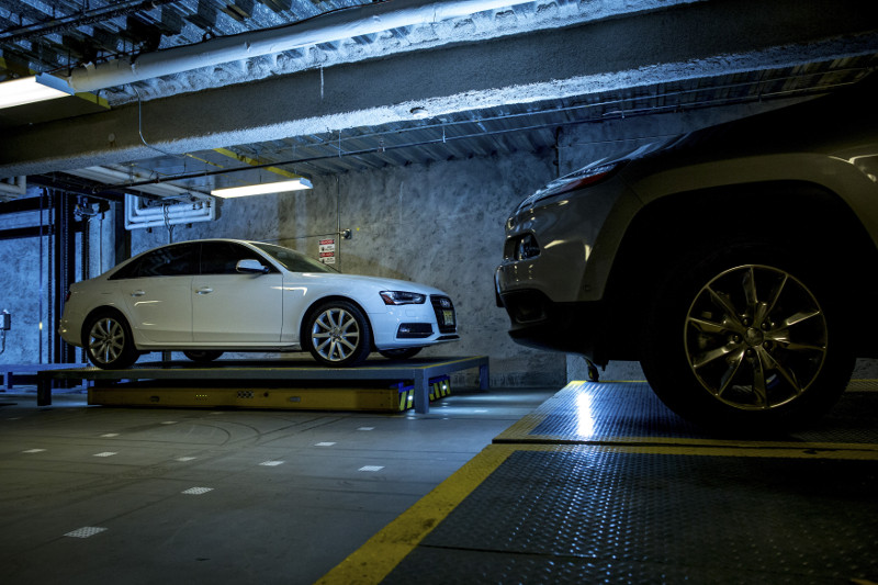 An automated vehicle carries a car to a space at a robotic parking garage in a residential building in New York, November 4, 2015. — Picture by Yeong-Ung Yang/The New York Times
