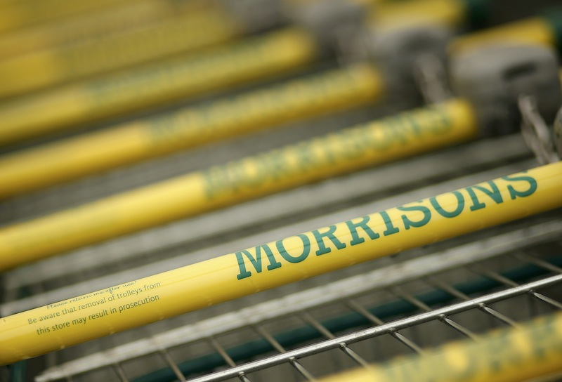 Shopping trolleys stand outside a Morrisons supermarket in Liverpool, Britain, in this file photograph dated March 12, 2015. — Reuters pic