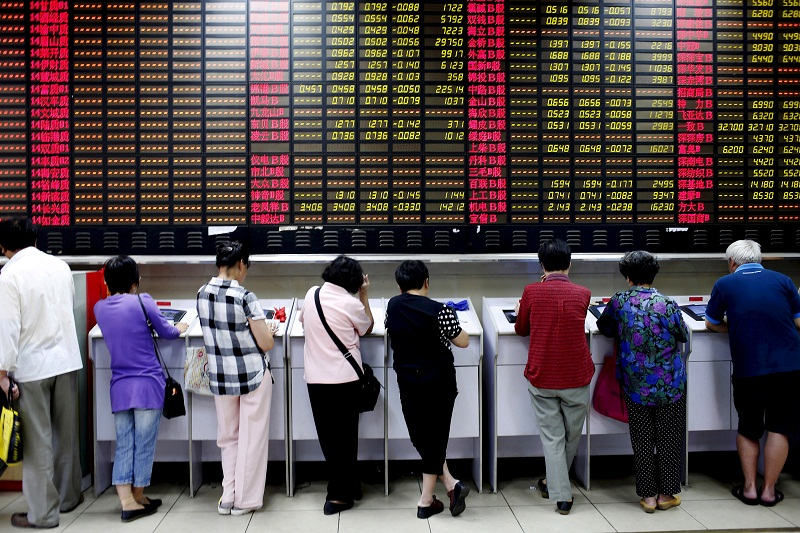 Investors look at computer screens showing stock information at a brokerage house in Shanghai, China, in this July 8, 2015 file photo. — Reuters pic