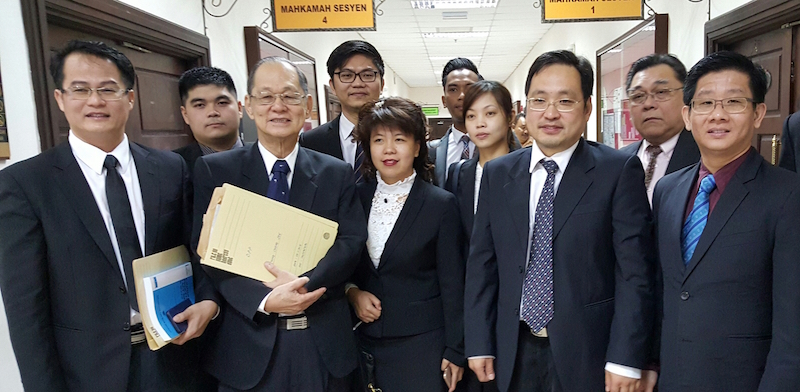 Sarawak DAP chairman Chong Chieng Jen (2nd right) and Stampin MP Julian Tan (right) with counsels Yap Hoi Liong (left) and Chong Siew Chiang (2nd left) after their court appearance at the Sessions Court in Kuching, December 14, 2015. — Picture by Sulok Tawie