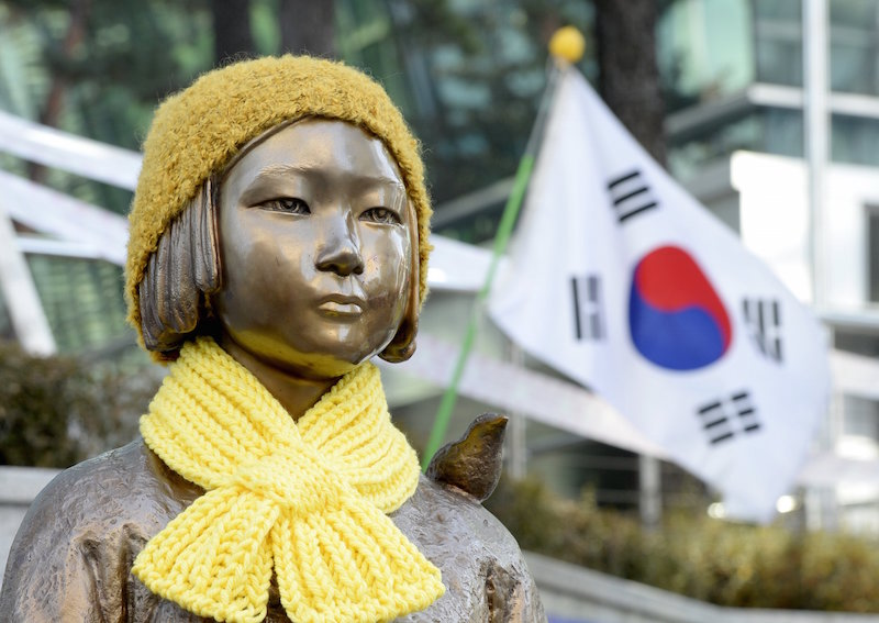 A statue of a girl that represents the sexual victims by the Japanese military is seen in front of Japanese embassy in Seoul, South Korea, December 28, 2015. — Reuters pic