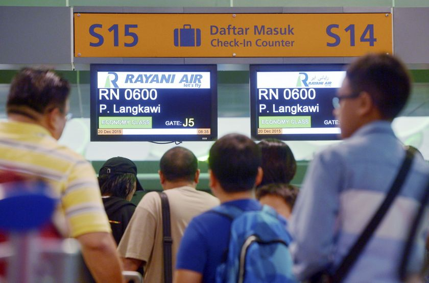 File picture shows Rayani Air passengers checking in for a Kuala Lumpur to Langkawi flight. — Bernama pic
