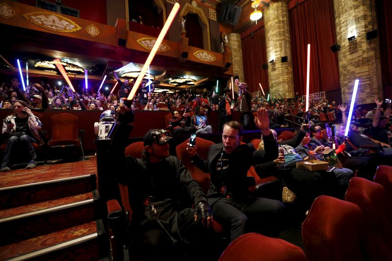 Moviegoers cheers and wave lightsabers before the first showing of the movie 'Star Wars: The Force Awakens' at the TCL Chinese Theatre in Hollywood, December 17, 2015. — Reuters pic