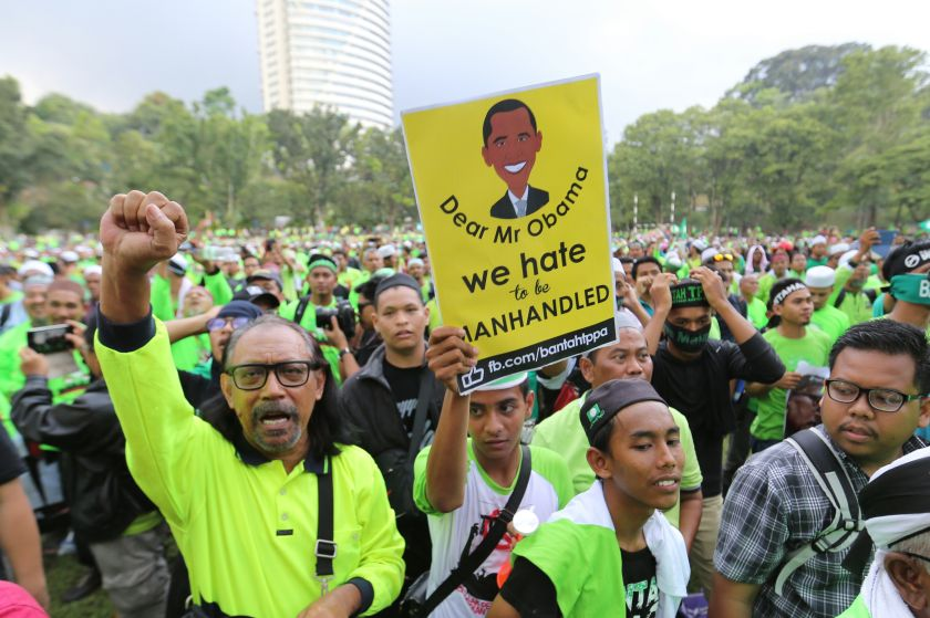 Anti-TPP  protester hold up banners at the anti-TPP rally at Padang Merbok in Kuala Lumpur, January 23, 2016. — Picture by Saw Siow Feng