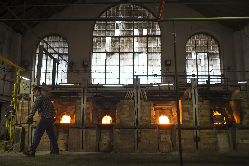 A worker scoops molten glass out of a furnace at the Preciosa Ornela bead factory in Desna, Czech Republic, January 6, 2016. ― Picture by Uriel Sinai/The New York Times