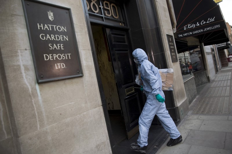 A police forensic officer enters a safe deposit building on Hatton Garden in central London April 7, 2015. — Reuters pic