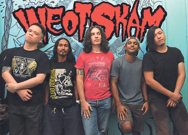 Marco Ferrarese (centre) is the lead guitarist for Malaysian thrashcore band WEOT SKAM. — Picture courtesy of Marco Ferrarese