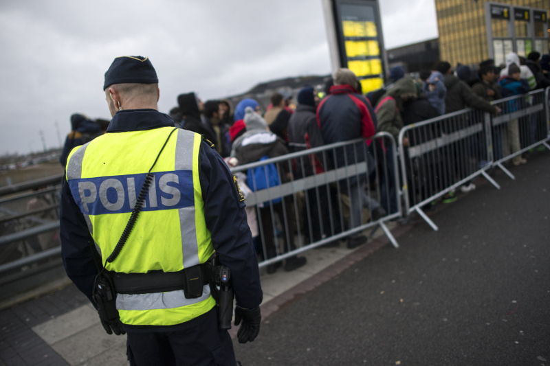 File picture of a police officer keeping guard as migrants arrive at Hyllie station outside Malmo, Sweden November 19, 2015. — Reuters pic