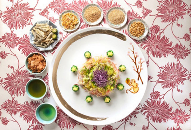 Min Jiang's crispy salmon skin lo hei is one of several creative options now that Goodwood Park Hotel has decided to take raw fish out of this year's Lunar New Year yusheng. — TODAY pic