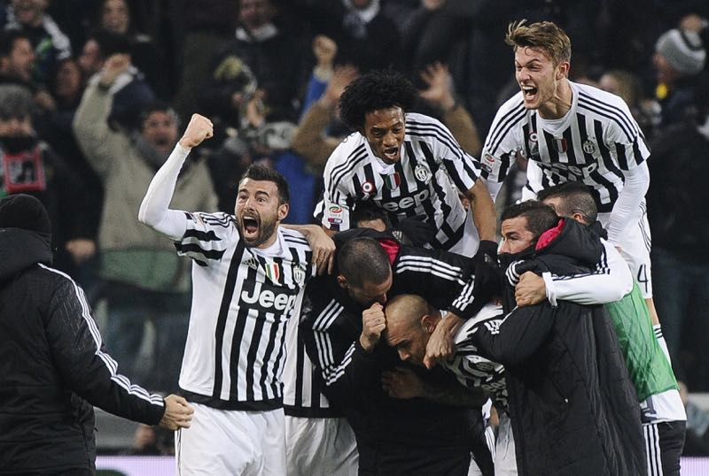 Juventus' Simone Zaza is celebrated by teammates after scoring during their match against Napoli at Juventus Stadium in Turin, Italy, February 13, 2016. — Reuters pic
