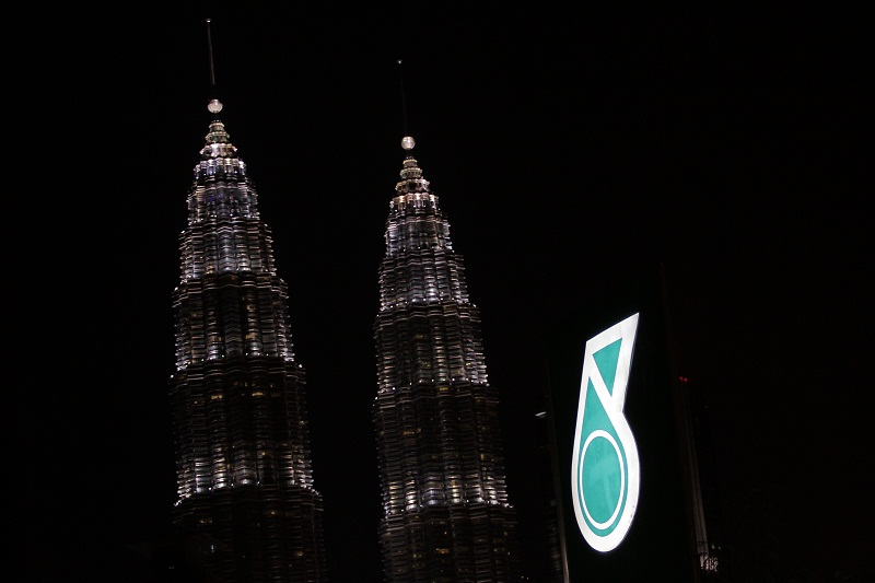 The Petronas logo is seen against the Petronas Twin Towers. Petronas today said it has made an oil discovery at the Hidayah-1 exploration well in Indonesia through its subsidiary PC North Madura II Ltd. — Picture by Yusof Mat Isa