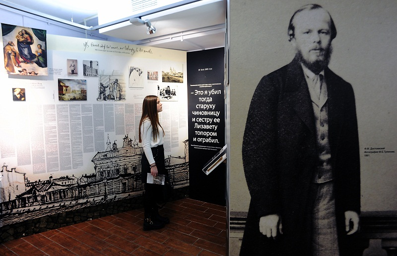A woman visits an exhibition commemorating the 150th anniversary of the publication of Russian writer Fyodor Dostoyevsky's Crime and Punishment at the author's museum in Saint Petersburg January 21, 2016. — AFP pic