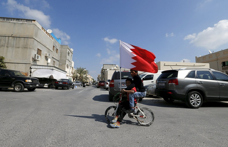Youths are seen cycling with a Bahraini flag in the village of Diraz west of Manama, Bahrain on February 12, 2016. Bahrain's highest court upheld three-year jail sentences against three relatives of a prominent exiled political activist, a rights group said February 25, 2019, a case the UN describes as an unlawful act of reprisal over family connections. — Reuters pic