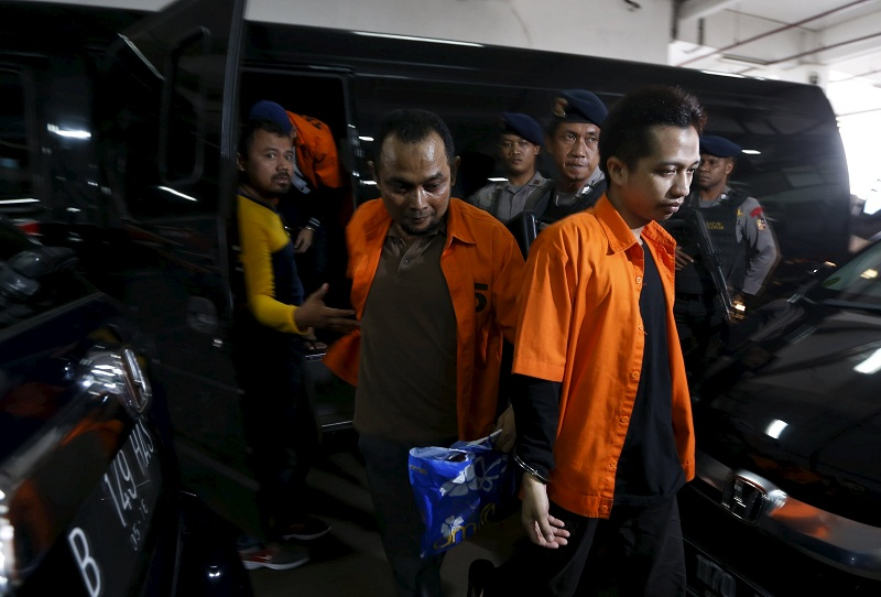 Indonesian policemen stand guard as accused supporters of Islamic State arrive for their trial at the West Jakarta court in Jakarta, Indonesia in this February 9, 2016 file photo. — Reuters pic
