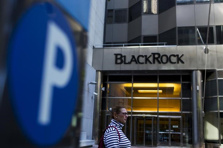 A woman walks next to a BlackRock sign pictured in the Manhattan borough of New York, October 11, 2015. — Reuters pic