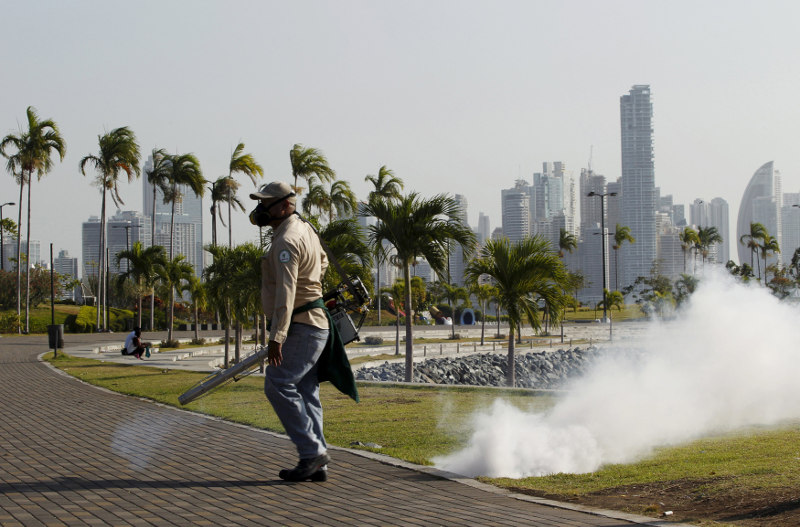 File picture shows a health worker carries out fumigation as part of preventive measures against the Zika virus and other mosquito-borne diseases at the seafront in Panama City, February 2, 2016. — Reuters pic