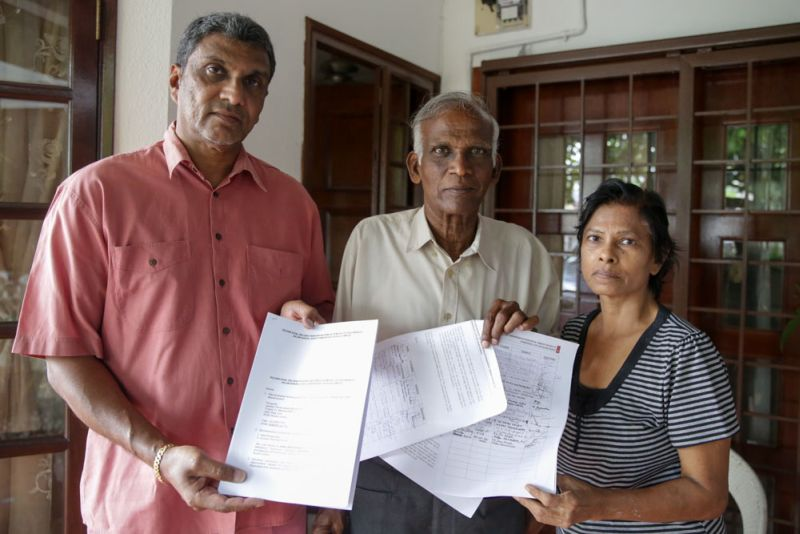 Rajkumar, Thiran and Sarojini managed to get over 30 residents around Jalan Kasah to sign the petition against allowing residential buildings be converted for commercial use. ― Pictures by Choo Choy May