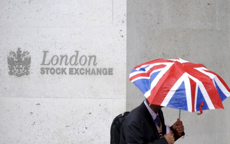 The blue-chip FTSE 100 closed 0.9 per cent lower, weighed down by a 4 per cent decline in Royal Dutch Shell Plc after it said it planned to write down the value of its assets by up to US$22 billion (RM94.3 billion) on a lower outlook for oil and gas prices. ― Reuters pic
