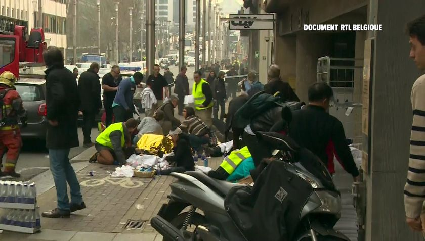 Rescue workers treat victims outside the Maelbeek metro station after a blast, in Brussels, Belgium, in this image taken from a March 22, 2016 video. ― Reuters pic