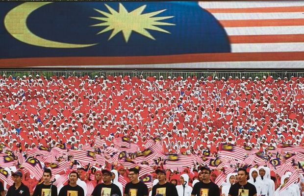 Participants waving the Jalur Gemilang at the Merdeka Day parade in Kuala Lumpur last year. The writer believes every citizen wants to live honourably and with dignity.