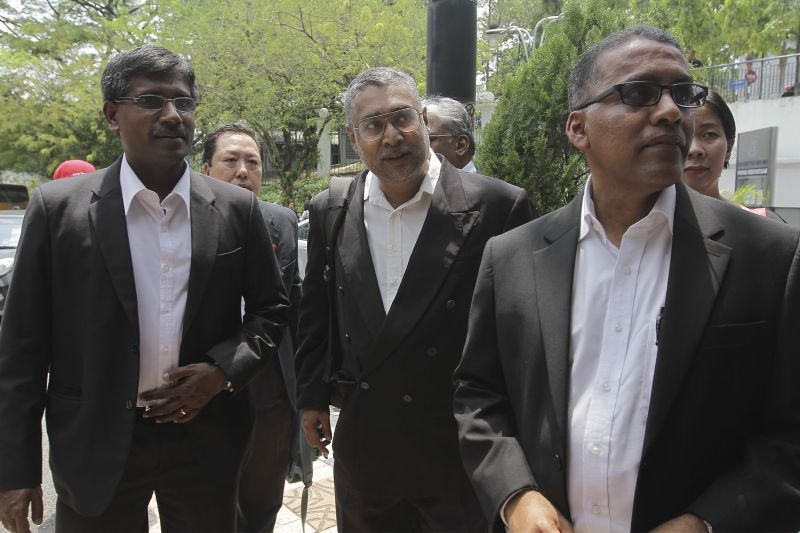 Charles Hector (centre), R. Shanmugam (left) and Francis Pereira arriving at Bukit Aman to give their statements regarding a sedition investigation in Kuala Lumpur, March 31, 2016. — Picture by Yusof Mat Isa