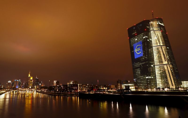 The headquarters of the European Central Bank (ECB) illuminated with a giant euro sign at the start of the 'Luminale, light and building' event in Frankfurt March 12, 2016. REUTERS/Kai Pfaffenbac