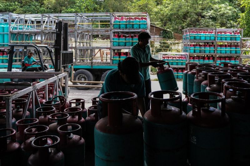 Workers arrange refilled Petronas gas cylinders at a shop in Ampang, Kuala Lumpur March 1, 2016. ― AFP pic