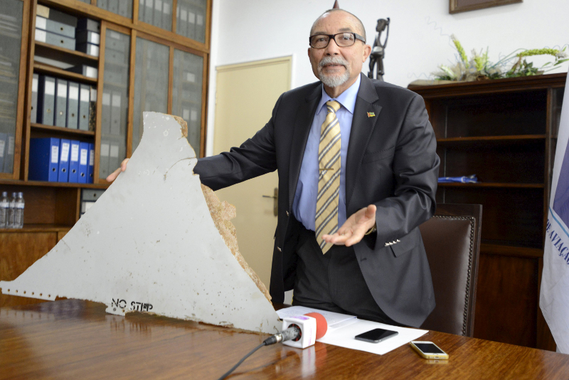 The head of Mozambique's Civil Aviation Institute, Comandante Joao Abreu, shows a piece of debris found on a beach that could be from a missing Malaysia Airlines flight MH370, in Maputo, March 3, 2016. — Reuters pic