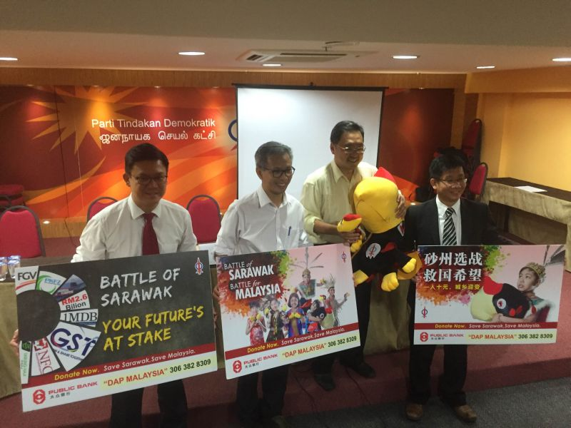 DAP's Tony Pua (second left) and Chong Chieng Jen launching the National Fund-Raising Campaign for the Sarawak elections. ― Picture by Kamles Kumar
